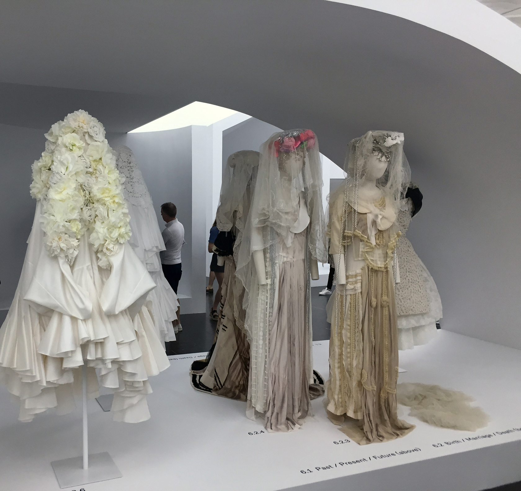 """4892a102a A verging-on-Victorian wedding dress, """"The Broken Bride"""", in the  """"Birth/Marriage/Death"""" collection, drapes elegantly in a mélange of silk,  lace, ..."""